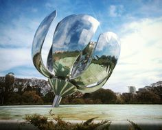 Floralis Generica is a Giant Metal Flower That Blooms Daily in Buenos Aires, Argentina.  Designed to bloom during the day and close at night just like most real flowers do, Floralis Generica is a beautiful metallic sculpture that popped up in Buenos Aires back in 2002. The amazing aluminum and stainless steel art piece was created by Argentine architect Eduardo Catalano.  Photo by val_yann via Instagram #amitrips #travel #trip #placestovisit