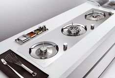 2009 was a good year for DigsDigs. Here are some best kitchen appliances that we covered: Whirlpool Domino Modular Hob New Ora-Ito White Kitchen Kitchen Hob, Stainless Kitchen, Open Plan Kitchen, Kitchen Storage, Kitchen Appliances, Kitchen Ideas, Kitchen Inspiration, Gas Stove, Interior Design Kitchen