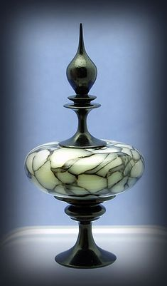 Debi Bouey,  Gallery B - blackwood base and finial, body made from a manufactured material called crushed opal turned vase