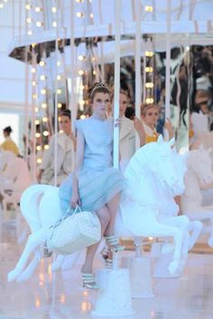 I want to wear a pretty dress and ride a carousel horse.