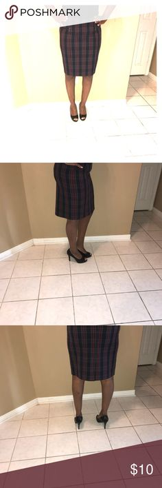 Plaid School Girl Style Skirt! Love!!!! This is a Navy Blue Plaid pencil Skirt with Mustard Red Gray Strips!! It has a small split in the back of the skirt and two gray chrome zippers on the front on each side. They are not pockets but a good fashion touch! This Skirt is 63% Polyester 33% Rayon 4% Spandex  Trim: 65% Polyester 35%Rayon Cato Skirts Pencil
