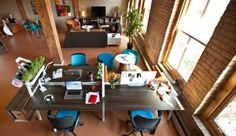 I like the use of open space and texture - the workspace is a little small and it looks like it would be a loud place to work with all the hard materials.