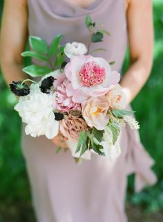 Colorful bridesmaid bouquet: Photography : Almond Leaf Studios Read More on SMP: http://www.stylemepretty.com/2016/07/27/this-backyard-wedding-is-basically-father-of-the-bride-irl/