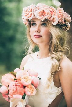 Pink rose flower crown for a boho bride with a side braid and pink peony bouquet.