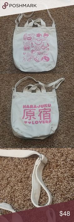 Harajuku lovers canvas crossbody bag Gwen stefani Harajuku lovers off white canvas crossbody bag with pink. Gwen Stefani. Euc. Smoke free pet friendly home. Approximate measurements inches 14.5 wide and 15 inches tall. Adjustable strap. 30 inch strap so 15 inch drop at longest. Can be worn crossbody or like a regular purse. Snap closure. Gwen Stefani bag crossbody canvas harajuku lovers Harajuku Lovers Bags Crossbody Bags