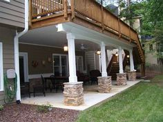 Love the white pillars and white ceiling under the deck.