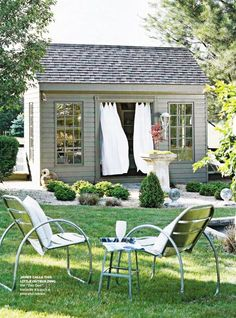 Outdoor space with billowing drapery. So pretty!
