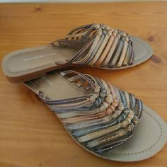 NWOT Bandolino metallic multi colored sandals Only worn once I side. These metallic neutral colored slip on sandals are a must have for this summer. Perfect for a day at the beach, pool, etc. Size 8M Bandolino Shoes Sandals
