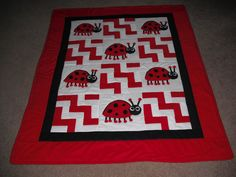 Ahhhh.  Adorable Red And White Appliqued Ladybug Baby Quilt