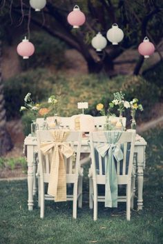 Mint and pale yellow chair bows