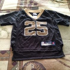 REGGIE BUSH #25 SAINTS AUTHENTIC NFL RBK JERSEY. Toddler, Black and Gold Jersey short sleeve, v-neck, excellent condition. Reebok Shirts & Tops