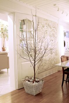 This idea may look nice in Livingroom?  Different color with large basket and tree branches.