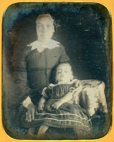 Daguerreotype of a young mother clutching her deceased child