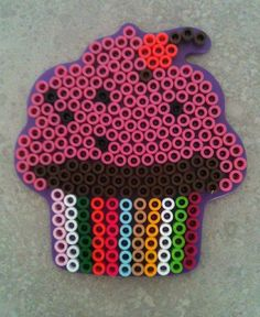 Entertain the kiddos with Perler Beads!  Timeless and inexpensive.  Great Summer Boredom Buster.  We stick a magnet to the back and use them on the fridge to hold papers.