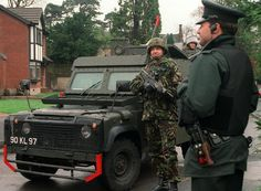 rideoutprotectorsoftherealm:  Soldiers of 1 Battalion, Royal Anglian Regiment and a British Army Snatch Land Rover accompany an officer of the Royal Ulster Constabulary on patrol in Belfast in 1997.