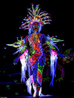 Glow in the dark: The festival, which saw competitors dressed as geishas, superheroes and mermaids, is a UV painting contest