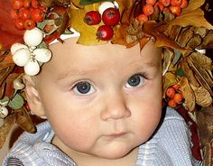 This poor baby looks dressed as a centerpiece ready for the middle of the Thanksgiving dinner table?