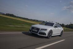Dan Carney takes Audi's coupe-like sedan on a bombing run through the Nevada desert. Audi Rs7 Sportback, Automobile Companies, Bentley Car, Volkswagen Group, Auto News, Car Photos, Bmw, Cars, Luxury