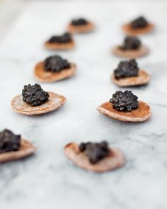 Caviar on blini served with chilled vodka