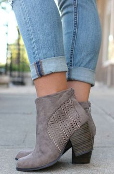 "Must have taupe booties. Striking cut out design. 3"" heel. Back zipper."