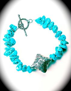 Natural turquoise bracelet w/sterling silver Bali focal bead & toggle (fabulously priced).