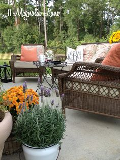 Fall-colored throw pillows add a dash of color to this outdoor conversation area and make it a cozy spot for relaxing.  Add an outdoor lantern and a few pots of fall flowers and you've just extended the functionality of your deck, porch or patio through the cooler months!   {Sponsored by HomeGoods}