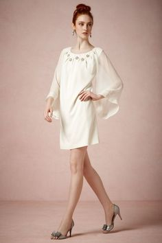 elegant bubble-sleeve cream wedding reception cocktail dress