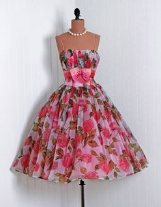1950s vintage dress. I just want a reason and an occasion to wear a dress like this. Feminine, floral, pink