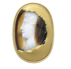 A sardonyx cameo of a lady, Roman, 1st-2nd century AD Oval, the cameo fragment depicting a Roman lady of high rank, possibly royal, in profile facing right, repaired with gold and in a later setting,