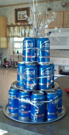 Bud Light Cake. Made this as a gift for our friends and it was a hit! Picked up platters and ribbon at the Dollar Tree, used 19 of the 24 cans of beer. Spent less than $25.