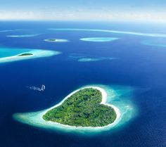 Heart-shaped island in the Republic of the Maldives. The Maldives is the smallest country in Asia but this country is regarded as the paradise of the world. Heart-shaped Island is one of many beautiful natural wonders in Maldives Resorts, Places To Travel, Places To See, Vacation Places, Italy Vacation, World Most Beautiful Place, Heart In Nature, Romantic Destinations, Romantic Places