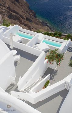 Cycladic style architecture and private terraces with plunge pools high up on the cliffs of the caldera Kirini Suites & Spa in Santorini