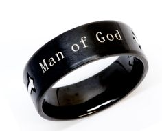 Our Man of God - Passion Ring is a brushed stainless steel black double cross ring with high  polished crosses. This is a great product that you are sure to love when you see the real thing on your finger.