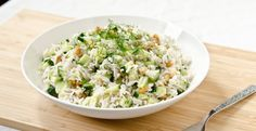 For the Salad: 1 cup of uncooked long-grain white rice such as Basmati or rice of choice 2 cups of water 1 medium English cucumber, diced 1 cup of walnut pieces 1 heaping tablespoon of fresh chopped dill 1 heaping tablespoon of fresh chopped mint Juice from 1/2 a lemon For the Dressing: 2 tablespoons...