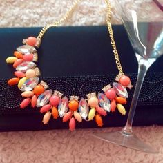 Bib Style Statement Necklace Beautiful Statement Necklace with bright colored geometric pieces.  This is a great piece that can be dressed up or worn casual. NWOT, never worn. Boutique Jewelry Necklaces
