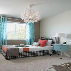 Turquoise, orange, black and white bedroom.