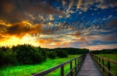 Sunrise over the wildlife refuge.  by Dean Tunberg -  Click on the image to enlarge.