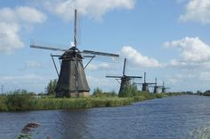 The windmills at Kinderdijk are a group of 19 monumental windmills in the Alblasserwaard polder, in the province of South Holland, Netherlands. Most of the mills are part of the village of Kinderdijk in the municipality of Molenwaard, & one mill, De Blokker, is part of the municipality of Alblasserdam. Built in 1738 & 1740, to keep water out of the polder, it is the largest concentration of old windmills in the Netherlands. They have been a UNESCO World Heritage Site since 1997.