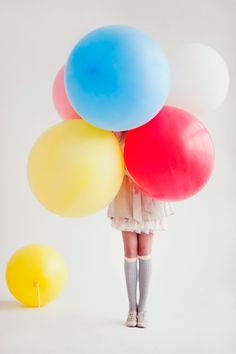 big balloons, little person