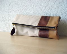 Hand crafted in Switzerland form scrap leather.
