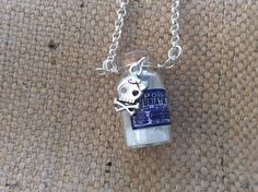 Cute silver pendant with mini vial of poison! Actually the glass bottle contains edible glitter. All topped off with a skull and crossbones death head charm. Perfect for chemists, goths and all lovers of apothecary themed jewelry. From Mums Jewellery shed on Facebook.