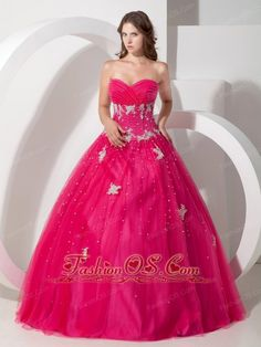 Pretty Hot Pink Sweetheart Quinceanera Dress with Appliques and Beading  http://www.fashionos.com  Fuller dress with more ornate designs are becoming more popular. This one features a strapless bodice with a sweetheart neckline and lovely floral appliques throughout. The bodice has been heavily embellished with beautiful beads and appliques that extend all the way across the front and back of the dress. The A-line skirt is full and shapely.