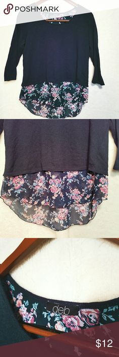 Deb XL Navy knit 3/4 top floral sheer split back Deb brand. This navy blue knit top has sheer floral underlay and a split open back. In excellent condition, only worn a few times. 3/4 sleeves. XL. Deb Tops Blouses