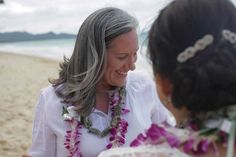 Angel and Belinda's intimate destination beach wedding: Waimanalo, Hawaii  Visit equallywed.com for the full feature and more LGBTQ weddings and equality-minded wedding vendors. Photography: The Argus Image Florist: A Rainbow in Paradise Officiant, Coordinator: Kalona Ortiz Attire: JCPenney, Coldwater Creek, Teva Filed under: Hawaii, travel, destination weddings, LGBTQ, lesbian, brides, outdoors, beaches, ukulele, gay, Equally Wed, ocean, water, romance, shells, marriage, Polynesian…