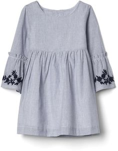 Smooth woven, fully lined. Long sleeves with bell cuffs. Round neckline. Shirring at waist seam adds fullness. Keyhole button & loop closure at back. Assorted allover prints. Sizes 2T and under include a diaper cover. Note: Corsica Blue Stripe with embroidered floral detailing. #afflink