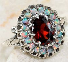 Silver ring with garnet and fire opals.