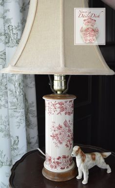 This antique transferware lamp is wired and sits on a wooden base. It features a lovely floral, from buds to full blooms. The pattern is Aster, by Spode. It has a built in harp which is sturdy and the
