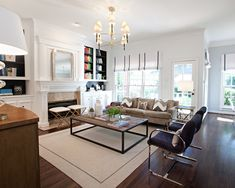 Sally Wheat Interiors: Chic living room with Jonathan Adler Ventana 2 Tier Chandelier, gray velvet sofa, ...