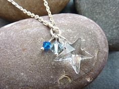 Swarovski Star Necklace with sparkly Swarovski crystal beads in shades of blue. This is a very pretty pendant charm necklace, ideal for any