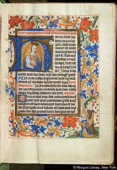 Book of Hours, MS S.1 fol. 16r - Images from Medieval and Renaissance Manuscripts - The Morgan Library & MuseumVirgin Mary and Christ Child -- Virgin Mary, crowned, emanting rays, in mandorla, as half figure on crescent moon, holds in her arms nude infant Christ Child, nimbed. Margins with vinescroll and floreate ornament, including dianthus. Vignette in lower right corner: Augustus: Prophecy of Sibyl -- Augustus, with joined hands raised, with imperial crown on ground, kneels beside Sibyl…